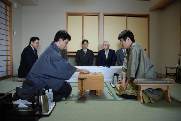 Professional players SATO Yasumitsu (left) and HABU Yoshiharu compete in the final best-of-seven games series in one of the major professional shogi tournaments. COURTESY OF JAPAN SHOGI ASSOCIATION
