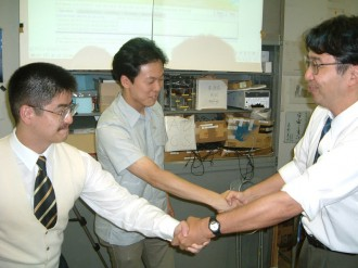 Nakasuka shook hands with project managers knowing  the success of launching XI-IV